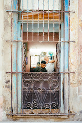 Barbeer Shop In Havana (Simone Della Fornace) Tags: street urban men window shop sony havana cuba culture streetphotography photojournalism documentary lifestyle frame journalism reportage barbeer a7rii