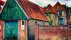 Cascading Rooftops (Alfred Grupstra Photography) Tags: houses wall nederland roofs nl medemblik noordholland