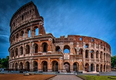 Colousseum at 7 am (D. Scott Taylor) Tags: rome colosseum italy blue red ancient