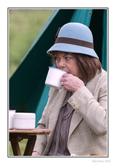 High Tea (Seven_Wishes) Tags: uk portrait people woman hat female person dof outdoor candid tent depthoffield northumberland mature ww2 hh kc brew gs reenactment worldwar2 newcastleupontyne blyth tyneandwear jdo womanportrait teadrinker photoborder tinmug blythbattery canoneos5dmark3 newcastleupontynenortheast canonef100400mmf4556lisii