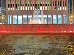 red (army.arch) Tags: city nyc newyorkcity red ny newyork water fountain night photography rockefellercenter harrisonandabramovitz exxonbuilding