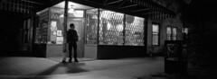 The Wilder Snail Grocery (Orion Alexis) Tags: street old blackandwhite panorama film monochrome silhouette shop night vancouver 35mm downtown noir widescreen east fujifilm neopan 100 hastings van cinematic across eastside cornerstore tx1
