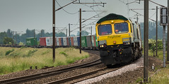 Powerhaul Freightliner Class 66/5 no 66504 approaches Gamston on 23-06-2016 with a Leeds to Felixstowe Intermodal (kevaruka) Tags: uk railroad morning blue summer england color colour green colors june yellow train canon eos star coast flickr colours britain outdoor united main great transport rail railway kingdom trains front 66 class line east page vehicle 5d british locomotive network nottinghamshire retford mk3 2016 freightliner ecml ef100400 railfreight gamston f4556l gbrf 66504 66702 5d3 66779 5diii thephotographyblog ilobsterit