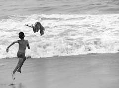 Jumping Jack  (SriramK10) Tags: jump acrobatic action beach waves sea joy monochrome blackandwhite nikond5500 pure