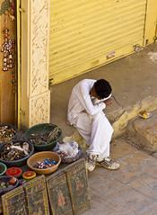 relax (Simone Chiarantini) Tags: india man relax asia market job jaisalmere