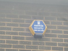 Photo of Sunwin Security alarm on Tonge Old Road Co-op store in Bolton (May13)