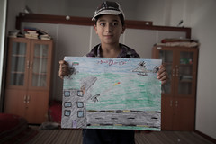 SYRIAN REFUGEE IN TURKEY. (Miguel Soffia) Tags: chile unicef camp miguel canon turkey children photography tents tv al war drawing refugee refugees border container syria 5d crayon coalition suffering dignity bashar unhcr resistance rebels assad markii rsf msf soffia poberty 2013 kilis
