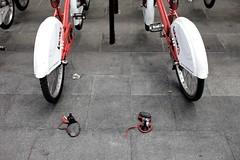 City bikes (pariya) Tags: barcelona street city red urban rot public bike female grey spain women shoes strasse rad streetphotography grau ground nobody abandon heels heel fahrrad pedal schuh boden parken pedale fussboden ffentlich hackenschuh bicing stadtfahrrad