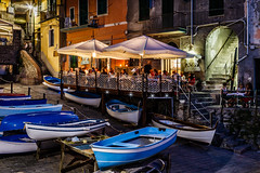 Illuminated Street of Riomaggiore in Cinque Terre at Night, Italy (ansharphoto) Tags: road street old city travel blue vacation people italy house history tourism electric architecture night stairs umbrella buildings boats lights restaurant evening coast town cafe twilight italian europe downtown mediterranean italia european arch village view darkness dusk liguria culture landmark cobbled illuminated resort parasol terre romantic cinque riomaggiore nightfall riomagiore