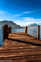 Sunny Jetty (YuriFineart) Tags: winter mountain lake snow cold canon lens landscape switzerland fantastic angle wide plastic kit 1855 18mm 600d