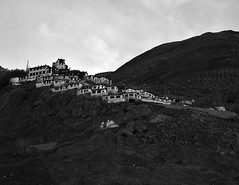 A Monastery (Sakshi Kumar) Tags: travel red portrait blackandwhite bw india mountain snow nature clouds photography buddhist buddhism monks traveling leh ladakh travelogue jammukashmir monotones incredibleindia indianimages monklife