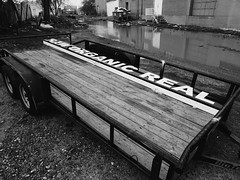Raw, Organic, Real. (BurlapZack) Tags: bw monochrome sign trash real puddle found mono alley junk raw litter warehouse alleyway signage organic trailer smoothies crunchy 43 fruitjuices lunchbreak dallastx capslock soreal standingwater allcaps designdistrict juicetown soraw juicestore vscofilm panasoniclumixlx100 smoothiepeddlers