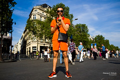 Street -The Orange Man (Franois Escriva) Tags: street blue people orange cloud sun man paris france clouds buildings clothing candid champs elyses streetphotography olympus clothes sly avenue omd