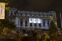 Video mapping Cercul Militar (Od Bucuriei) (georgemoga) Tags: street longexposure light people building statue festival spotlight romania column ro bucharest bucureti municipiulbucureti