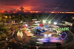 revolution of the sun (DOLCEVITALUX) Tags: sunset people sun lights dusk philippines manilabaysea