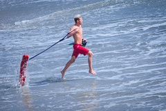 Oceanside Lifeguards (EthnoScape) Tags: ocean california red summer rescue tower beach water youth danger swimming swim training athletic surf surfer lifeguard tourist rubber safety health bikini oceanside shore surfboard swimmer boardshorts fiberglass swimmers athlete fitness rookie assistance trainer fins drowning drown wetsuit baywatch lycra lifesaver riptide rescuing lifeguardtower lifeguards lifesavers touristseason neoprene swimfins ripcurrent rescuer ethnoscape rescuetube cityofoceanside polyeurathane ethnoscapeimagery