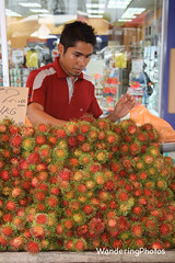 Rambutan Seller - Kuala Lumpur Malaysia (WanderingPhotosPJB) Tags: img malaysia kualalumpur kl fruit seller stall streetfood cart red colour colourful rambutan cmwdred colourfulworld