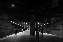 It's lonely on the platform /  the fifth wheel (zgr Grgey) Tags: street bw lines station train lowlight nikon geometry candid silhouettes couples istanbul d750 lonely 20mm voigtlnder darkcity 2016 samyang