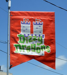 Dizzy Dragons Flag. (dccradio) Tags: carnival sky castle festival wisconsin clouds fun outdoors flag dragons bluesky fair powerlines event entertainment wires portage midway wi stmaryschurch amusements clearsky thrillride electriclines carnivalrides amusementrides communityevent fairrides utilitylines dizzydragons spinride sellner amusementdevice mechanicalrides larsoninternational larsonrides christmanamusements stmarysbestfest