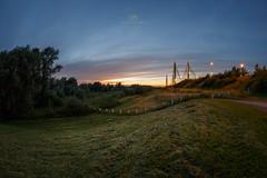 Sunset at the bridge (www.vangeloof.com) Tags: bridge light sunset sky sun netherlands night landscape low curves fisheye zaltbommel samyang