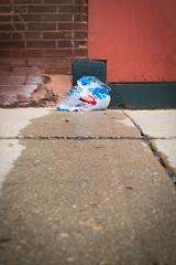 (192/366) Weeping in Heat (CarusoPhoto) Tags: hd pentaxda l 1850mm f456 dc wr re hdpentaxdal1850mmf456dcwrre john caruso carusophoto photo day project 365 366 pentax ks2 street side walk sidewalk ice bag melt heat tear weep water banal mundane everyday ordinary
