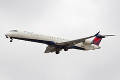 Delta Connection (SkyWest Airlines) Bombardier CRJ-900LR N820SK (jbp274) Tags: airport cloudy airplanes lax oo crj bombardier skywest klax deltaconnection