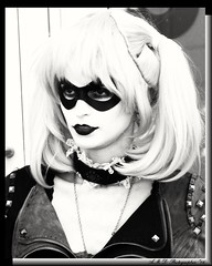 Harley Quinn (PhotoJester40) Tags: blackandwhite girl female outside outdoors costume pretty cosplay creative intriguing masked hq devilish bnw harleyquinn publicdomain madeup diabolical mischievious 8by10 jokersgirlfriend comicbookvillian