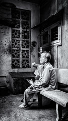Grandma snack break (Asian Hideaways Photography) Tags: asia asian people travel travelphotography urban vietnam old southeastasia streetphotography saigon street streetlife grandmother grandma granny hcmc woman candid blackandwhite bw