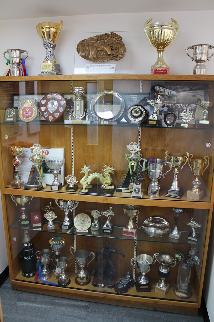 A Selection Of Older Trophies And Awards Crackers250 Tags Factory Tour Display Lotus