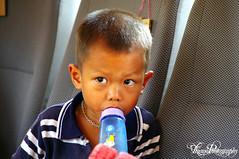 Laos kid / Enfant Laos (Arnaud_Tizano) Tags: portrait eye river kid young rivire laos enfant mekong