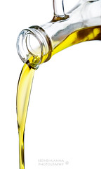 Olive oil (Annjutka) Tags: food white macro glass yellow vertical closeup studio gold golden bottle healthy raw natural juice background fat olive nobody vegetable fresh gourmet grease clear fluid virgin part vegetarian sunflower oil organic diet oliveoil pour liquid extra isolated pouring carafe nutrition ingredient
