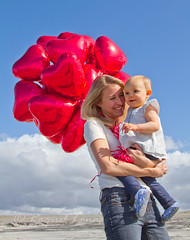 IMG_1292 (rlonas) Tags: california red sky baby love beach nature girl clouds balloons mom outdoors sand toddler child heart daughter mother valentine motherhood img1292 youngmother