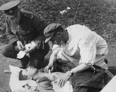 WWI0062B1 (ww1images) Tags: white station shirt soldier hit shot hole post notes chest wounded watch pad dressing pillow cap doctor blanket british bullet gown medic bandage injured gauze gunshot orderly tunic struck allied attend strecher