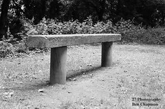 Bench (BenChapmanphoto) Tags: park white black slr film monochrome 35mm canon bench concrete 50mm photo seat iso 200 vista plus f18 agfa fd t70 suttonbridge