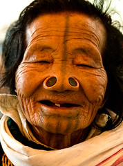 Smile (rob of rochdale) Tags: travel woman india smile tattoo tooth indian neindia arunachalpradesh northeastindia apatani noseplugs robhaich