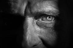 The sleepless (Giulio Magnifico) Tags: life lighting man black detail macro eye look closeup dark hope lights alone loneliness shadows expression character fear citylife streetphotography streetportrait sharp sick gaze glance sleepless glacial udine nikond800e nikkormicro105mmafsvrf28
