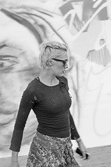 The Difference between Shooting Graffiti and Photographing People (zeevveez) Tags: zeevveez canon graffiti jerusalem woman people bw published model