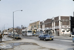 Wilson Avenue west of Wilson CTA station (UIC Digital Collections) Tags: stores automobiles streetscapes commercialbuildings hotelspublicaccommodations