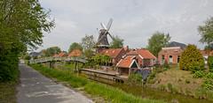 Mensingeweer (Grotevriendelijkereus) Tags: holland mill water netherlands windmill river town canal stream village nederland kanaal groningen molen dorp windmolen stroom mensingeweer