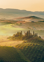 Beautiful sunrise over the Val d'Orcia in Tuscany, natural park included in the heritages list of UNESCO (Jaroslaw Pawlak) Tags: morning sunset italy house tree green nature beauty field fog farmhouse rural sunrise garden landscape dawn countryside spring amazing haze italian scenery italia mood view farm country hill foggy scenic meadow olive peaceful farmland tuscany mysterious cypress homestead pienza agriculture residence toscana picturesque idyllic dreamland scenics tuscan orcia quirico