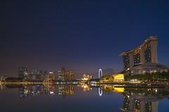 Marina Bay (ystan) Tags: reflection weather marina sunrise lights bay singapore ais20mmf28