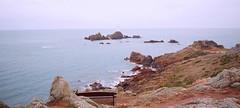 Jersey's Rugged coast  (Explored) (Bogger3.) Tags: lighthouse rocks relaxing thinking jersey seaview coth ruggedcoast soundofthesea coth5 soundodthesea