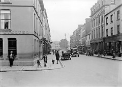 Hill Street, Hounds (National Library of Ireland on The Commons) Tags: ireland dogs bakery northernireland 20thcentury scotts eason ulster glassnegative countydown shelbourne hillstreet newry fordmodela ulsterbank nationallibraryofireland ulsterbanklimited easonson easoncollection easonphotographiccollection fredcorr acdowney cakeview