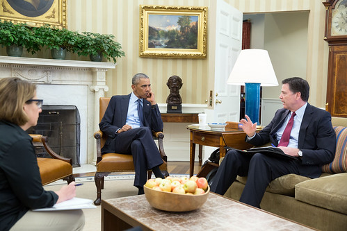 President Barack Obama and FBI Director James Comey discuss the mass s