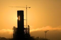 the PwC tower at sunrise (peet-astn) Tags: pwc pricewaterhousecoopers pwctower tower office midrand mallofafrica waterfall waterfallcorner johannesburg sun sunrise dawn alba crane cranes