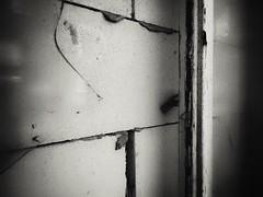 Viewless (J.C. Moyer) Tags: urban blackandwhite window glass bricks brokenglass urbanphotography bricked