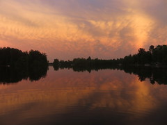 Orange sky after storms (yooperann) Tags: county summer sky orange lake rain evening bass michigan odd upper thunderstorm peninsula marquette gwinn
