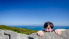 Lookout fun (Kathrin & Stefan) Tags: ocean newzealand sky nature rock fun island bush scenery outdoor lookout southisland tasmansea nzl rakiura riverton stewartisland foveauxstrait stefanmarks