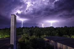 lightning (krelina) Tags: longexposure blue light wild chimney sky storm color building green industry nature weather clouds forest germany purple nrw lightning bielefeld
