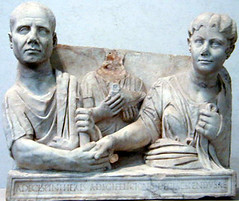Ancient Rome. Funerary Monument.  Wife and husband in 'iunctio dextrarum' with a male child between them holding a dove on the funeral urn of the Decii, Flavian/Trajanic middle class hairstyle, 98-117 AD. (mike catalonian) Tags: sculpture marble ancientrome funeraryart 2ndcenturyad funeralurn